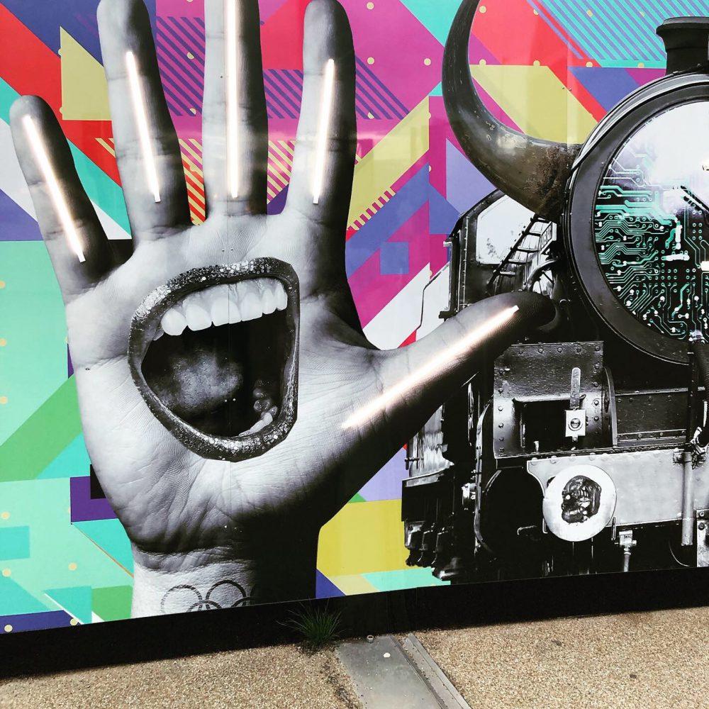 IQL Stratford Hoarding Hand Eye Design